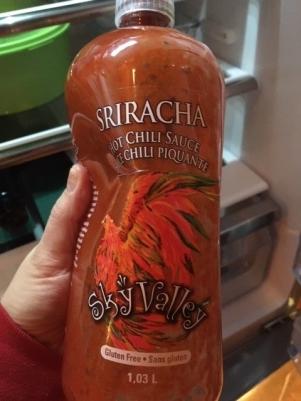 A 1.3 L bottle of Sky Valley Sriracha Hot Chili Sauce